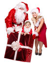 Santa claus family with child holding gift box isolated Stock Image