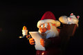 Santa claus figure toy with letter candle and cat Stock Image