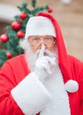 Santa claus with finger on lips Stockbild