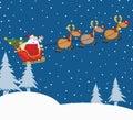 Santa claus in flight with his ren und pferdeschlitten Lizenzfreies Stockfoto