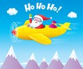 Santa Claus Flying An Airplane with Presents Royalty Free Stock Photo
