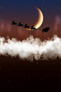Santa Claus is flying on a background of the moon Royalty Free Stock Photo