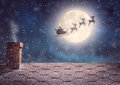 Santa Claus flying in his sleigh Royalty Free Stock Photo