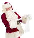 Santa claus gesturing at wish list Stockbild