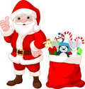 Santa Claus and gifts Stock Images