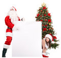 Santa claus and girl with banner by christmas tree Royalty Free Stock Photography