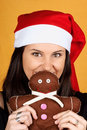 Santa Claus girl with gingerbread man puppet Stock Image