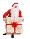 Santa Claus giving big gift box . Stock Photo