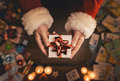 Santa Claus giving a Christmas present Royalty Free Stock Photo