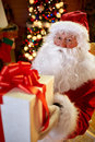 Santa Claus giving gift for you Royalty Free Stock Photo
