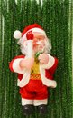 Santa Claus on a green New Year`s scenery