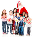 Santa Claus with a group of kids Stock Photo
