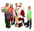 Santa Claus Handing out presents to kids isolated Royalty Free Stock Photo