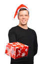 Santa claus hands a gift smiling man with christmas hat and presents Royalty Free Stock Images