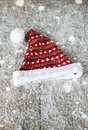 The Santa Claus hat on a wooden background in the snow Royalty Free Stock Photo