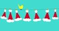 Santa claus hats on clothesline