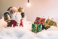 Santa claus hold the bell and star and light bulb stand in silent night, light up the hopefulness and happiness in Merry christmas