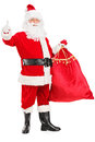 Santa Claus holding a bag and giving a thumb up Royalty Free Stock Photo