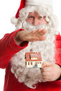 Santa Claus holding house Stock Photos