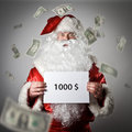 Santa Claus is holding a white paper in his hands. One thousand Royalty Free Stock Photo