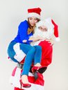 Santa Claus holding woman with christmassy hat Royalty Free Stock Photo