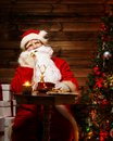 Santa claus in home interior talking over phone wooden Stock Photography