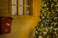 Santa claus house with letterbox and decorated christmas tree Stock Images