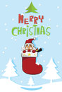 Santa claus inside red socks holidays christmas Royalty Free Stock Photo