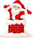 Santa Claus jumping from chimney Stock Photo