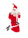 Santa claus jumping with thumb up sign isolated on white background Stock Photos