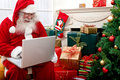 Santa Claus with a laptop Royalty Free Stock Images