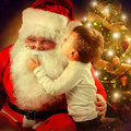 Santa claus and little boy christmas scene Royalty Free Stock Images