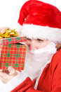 Santa Claus looking into gift box Royalty Free Stock Photos