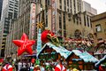 Santa Claus during the Macy`s Thanksgiving Day parade along Avenue of Americas with the Radio Music Hall in the background. Royalty Free Stock Photo