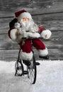 Santa Claus making christmas shopping with his bike. Funny idea Royalty Free Stock Photo