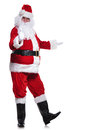 Santa claus is making the ok sign for something that he shows you on white background Royalty Free Stock Photography