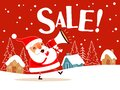 Santa Claus making sale announcement with megaphone Royalty Free Stock Photo