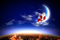 Santa claus moon above city night Royalty Free Stock Photo