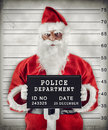 Santa claus mugshot of criminal under arrest Stock Photos