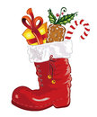 Santa claus nicholas colorful christmas boots with candy Royalty Free Stock Photo