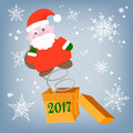 Santa Claus out of the box with a surprise congratulations Royalty Free Stock Photo