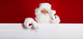 Santa Claus pointing in blank advertisement banner isolated on r Royalty Free Stock Photo