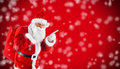 Santa Claus pointing in blank red with snow Royalty Free Stock Photo
