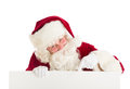 Santa claus pointing at blank sign portrait of against white background Royalty Free Stock Photo