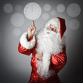 Santa Claus is pointing at the clock Royalty Free Stock Photo
