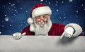 Santa Claus pointing in white blank sign with smile Royalty Free Stock Photo