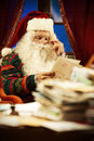 Santa claus portrait of reading a christmas letter Royalty Free Stock Photo