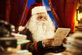 Santa claus portrait of reading a christmas letter Stock Photography