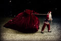 Santa claus pulls a huge bag of gifts in night pulling Royalty Free Stock Photography