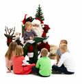 Santa Claus Reading his list with kids isolated Royalty Free Stock Photo